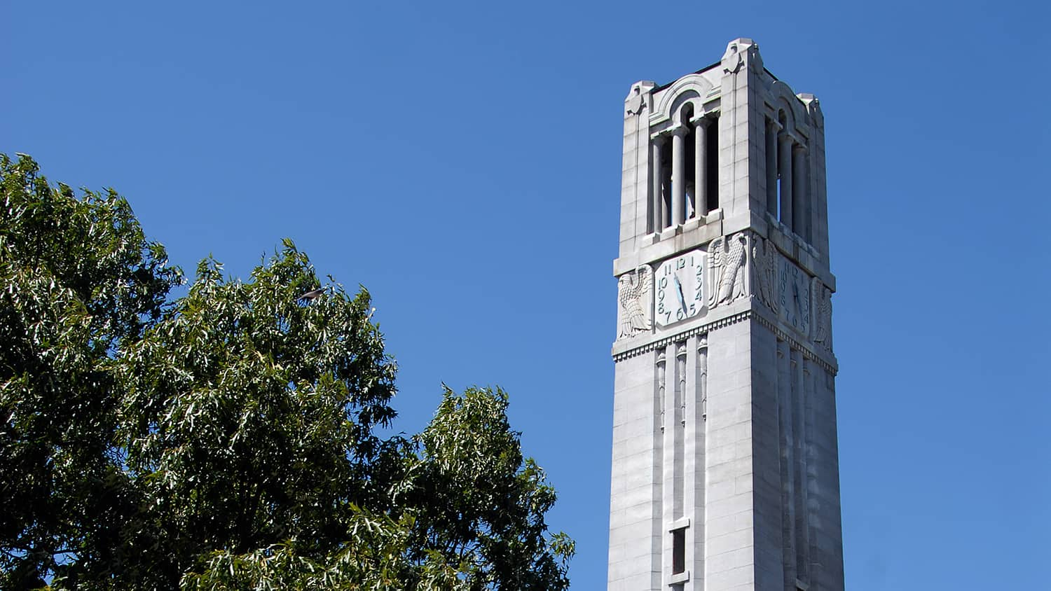 The belltower in front of a blue sky