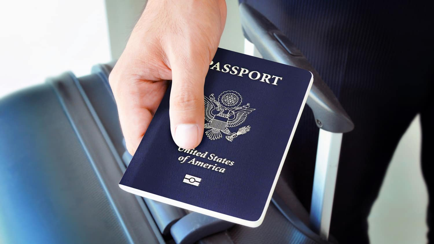 Study abroad student holding a passport