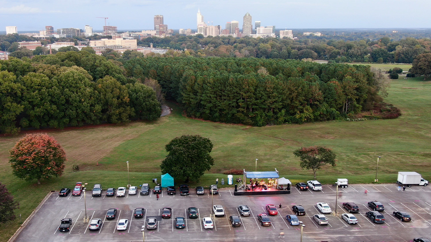 Vehicles in the parking lot on Centennial Campus for the Rissi Palmer drive-in concert this fall