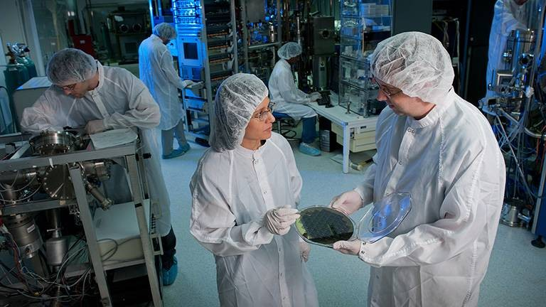 Dr. Veena Misra and Dr. John Muth at work in a high-tech ASSIST laboratory.