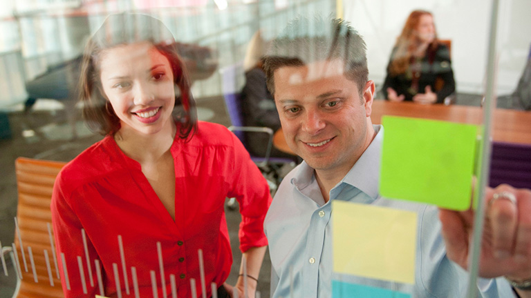 Young Professionals discussing topic in trendy office