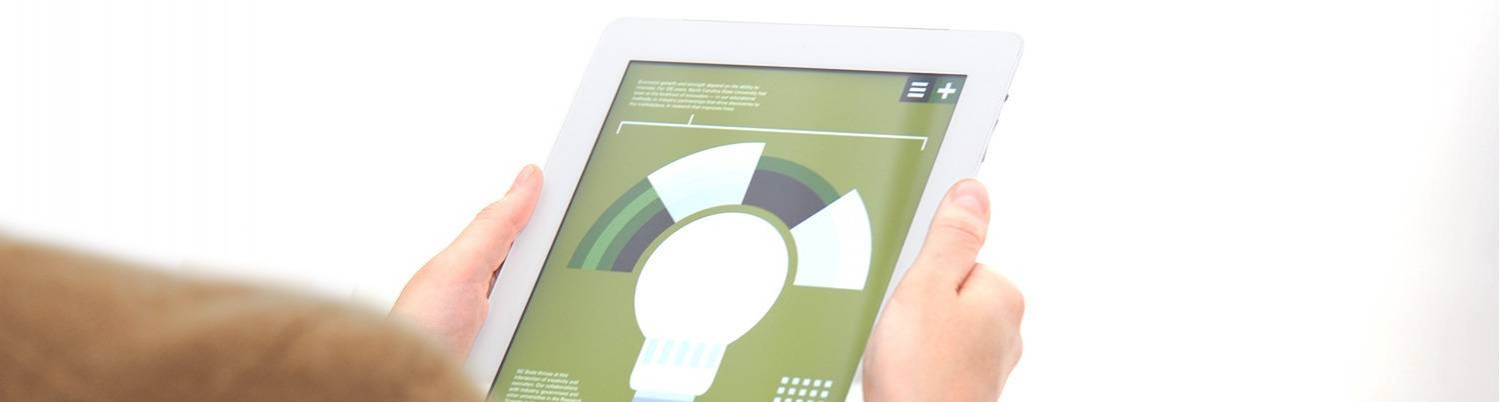 Hands holding iPad with lightbulb displayed on screen