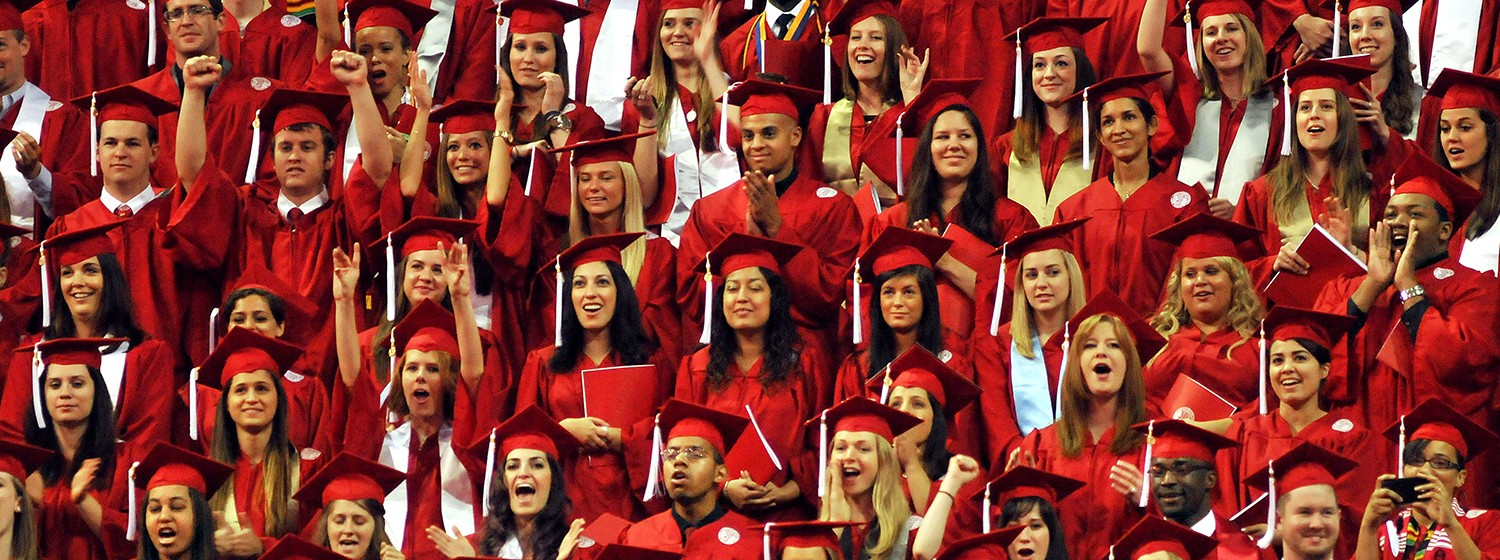 NC State graduates in red gowns
