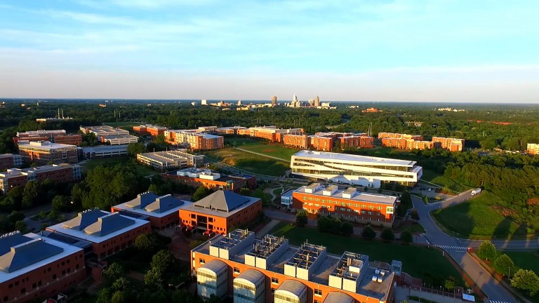 An aerial view of Centennial Campus with the Raleigh, NC, skyline in the distance.