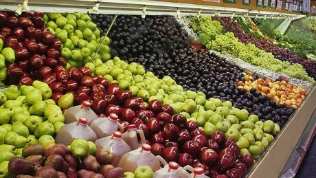 Apples in a grocery store produce section.