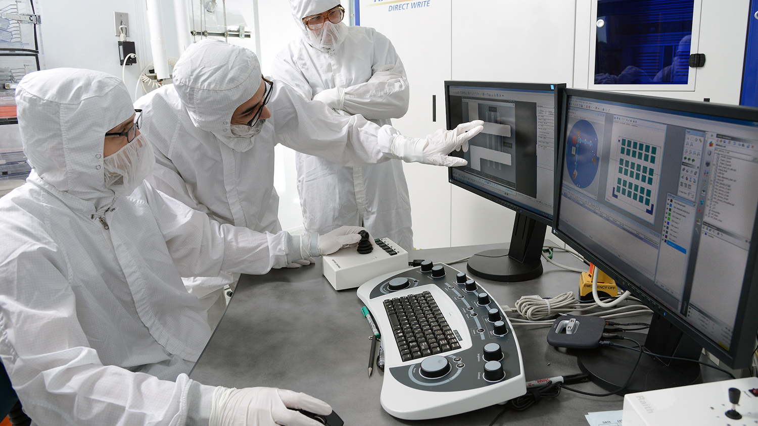 Three graduate students at work in the Microelectronics Research/Teaching laboratory at the Monteith Research Center on Centennial Campus.