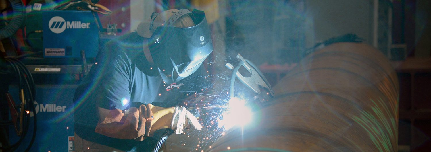 A person welds at the Constructed Facilities Lab on Centennial Campus