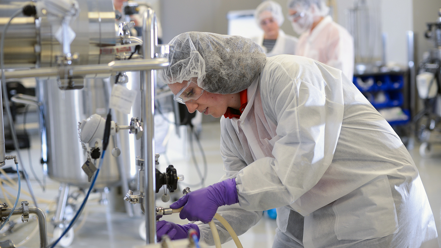 A graduate student at work in a biopharmaceutical lab.
