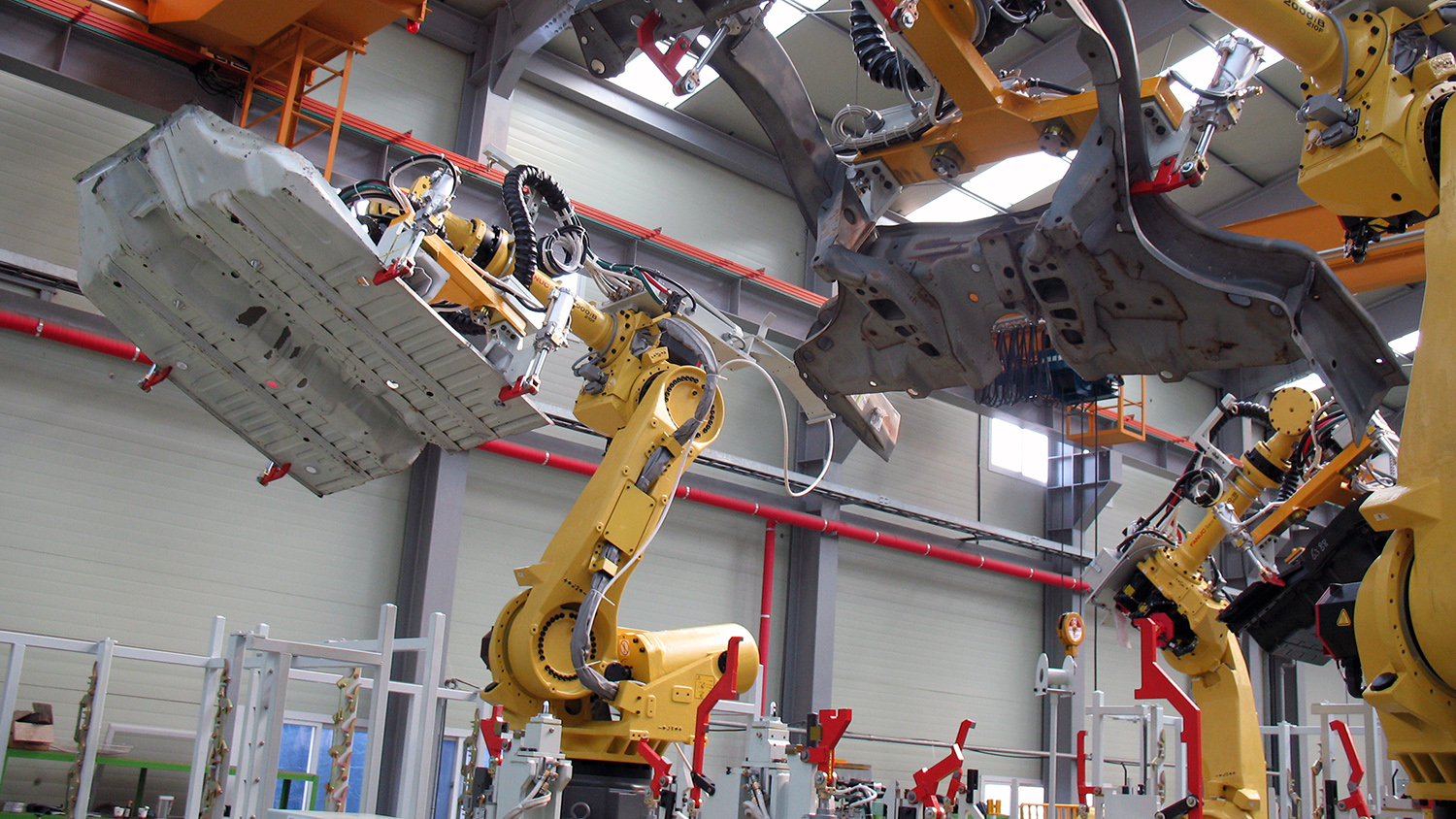Advanced manufacturing equipment in action in a factory.
