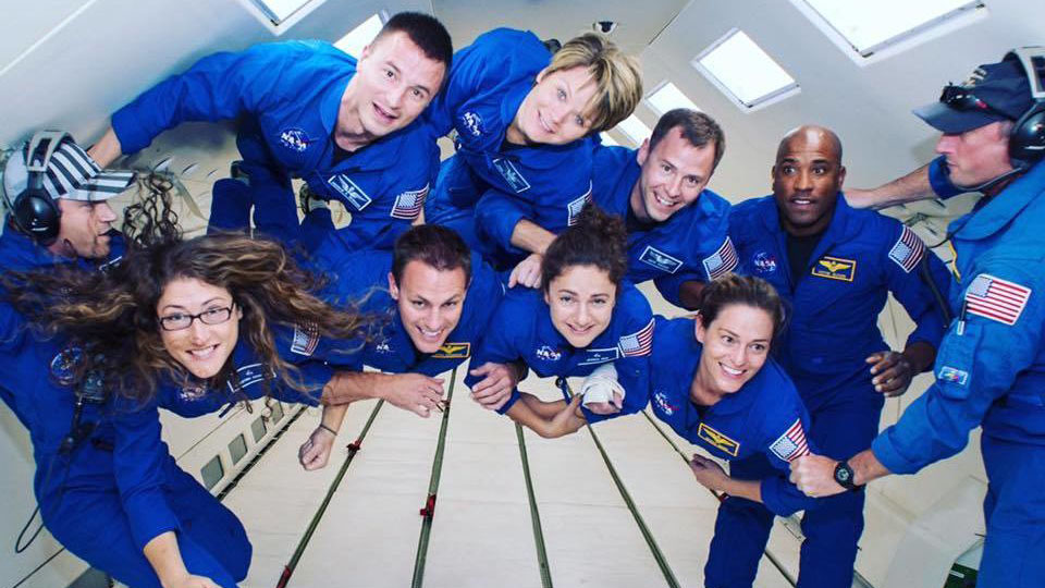 A group of astronauts including Christina Koch floating in microgravity
